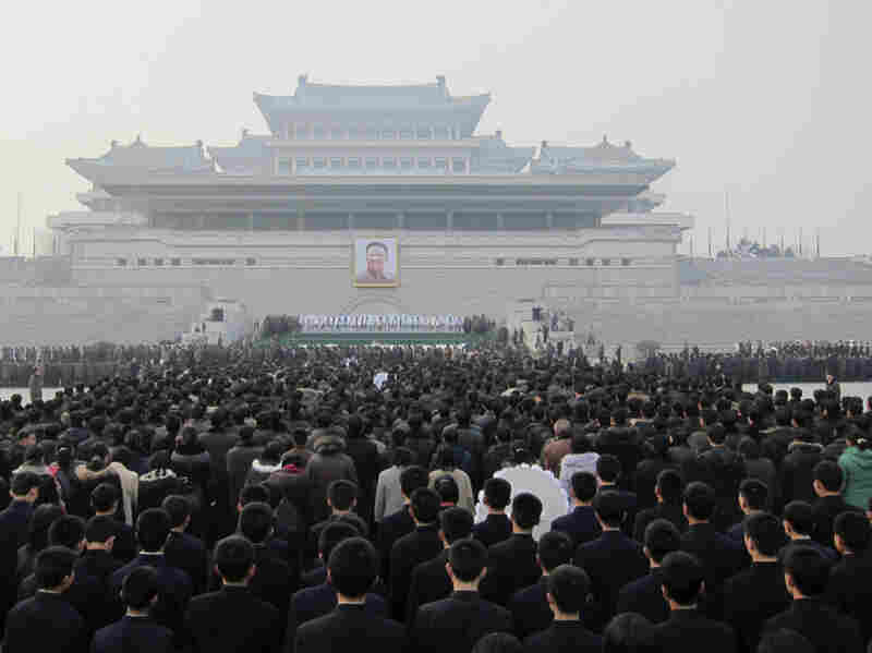 Hundreds of North Koreans queue up to mourn the death of Kim Jong Il in front of a portrait of him in Pyongyang's Kim Il Sung Square on Wednesday. With preparations for next week's state funeral still under way, attention is turning to Kim's son and heir apparent, Kim Jong Un.
