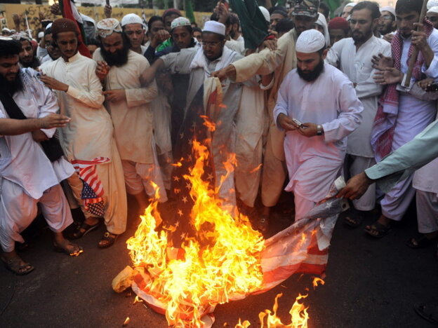 Protesters in Karachi, Pakistan, burned an American flag earlier this month to express their anger over the airstrikes that killed 24 Pakistani soldiers.