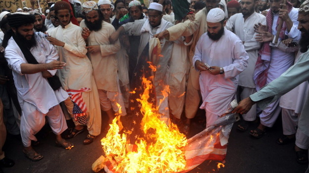 Protesters in Karachi, Pakistan, burned an American flag earlier this month to express their anger over the airstrikes that killed 24 Pakistani soldiers. (AFP/Getty Images)