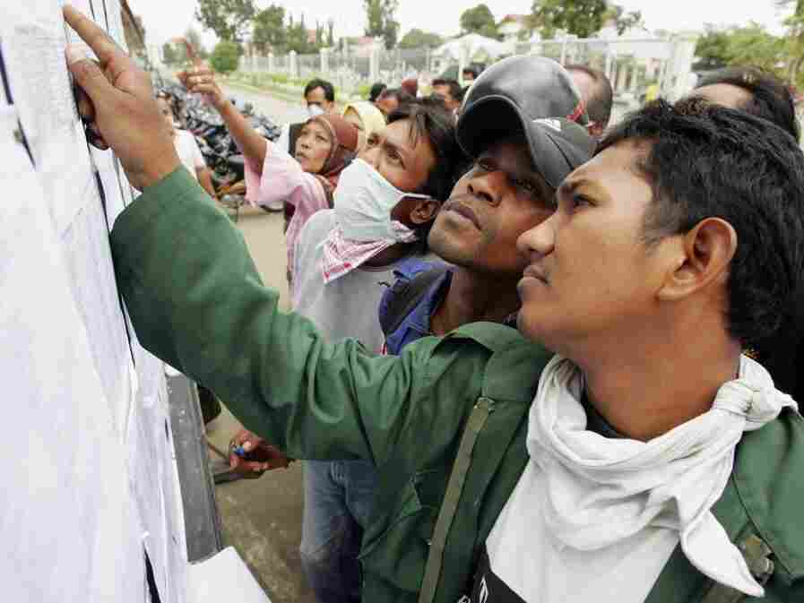 Jan. 4, 2005: Indonesians search for names of relatives on notice boards in Banda Aceh, one of the places devastated by the Dec. 26, 2004, tsunami.