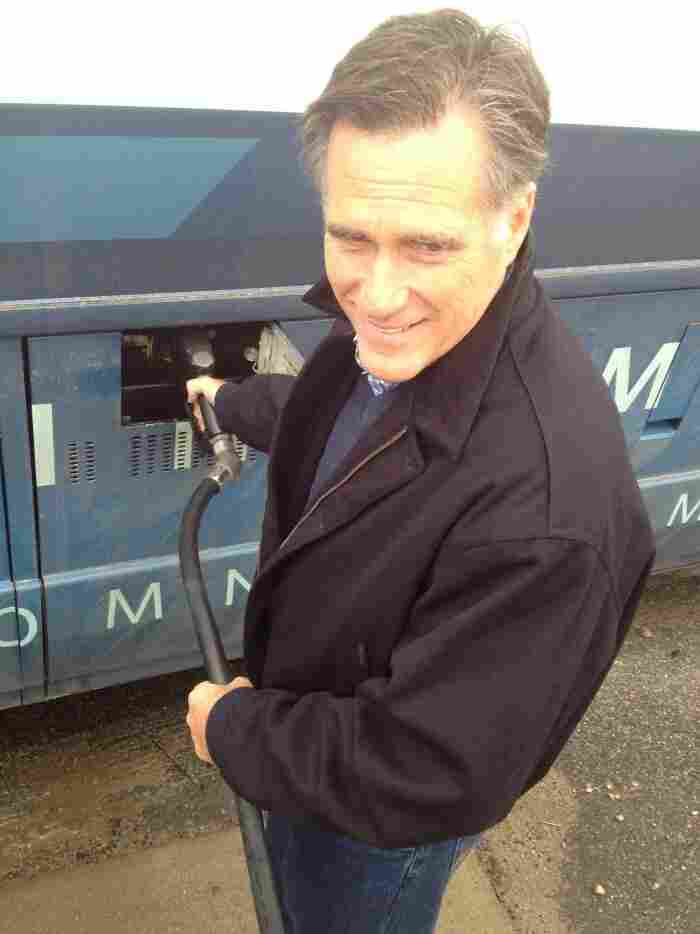 Romney pumped his own gas at a stop on his bus tour.