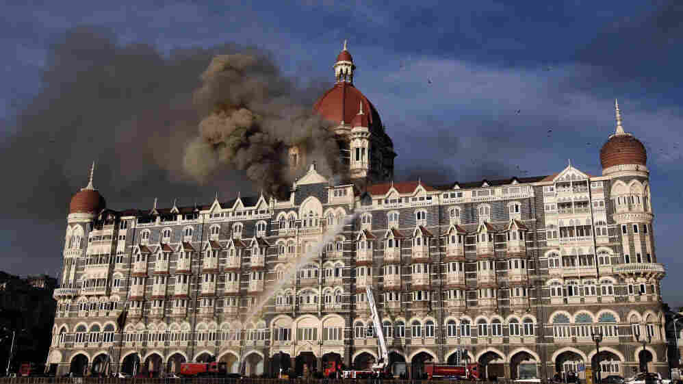 Indian firefighters attempt to put out a fire as smoke billows out of the historic Taj Mahal Hotel in Mumbai, which was stormed by armed gunmen in November 2008.