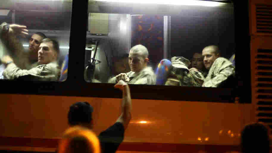 Josh Apsey, then an 18-year-old lance corporal, bumps fists with his dad through a bus window as he begins his trip to Afghanistan in 2009. Apsey is still in the Marines, serving in Virginia, and says the war in Afghanistan made him a different person.