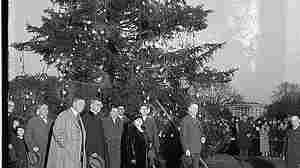 President Calvin Coolidge (right) with the national Christmas tree on Dec. 24, 1923.