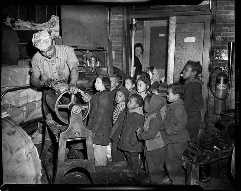 Children visit a printing shop, possibly at the Pittsburgh Courier, circa 1945-1949.