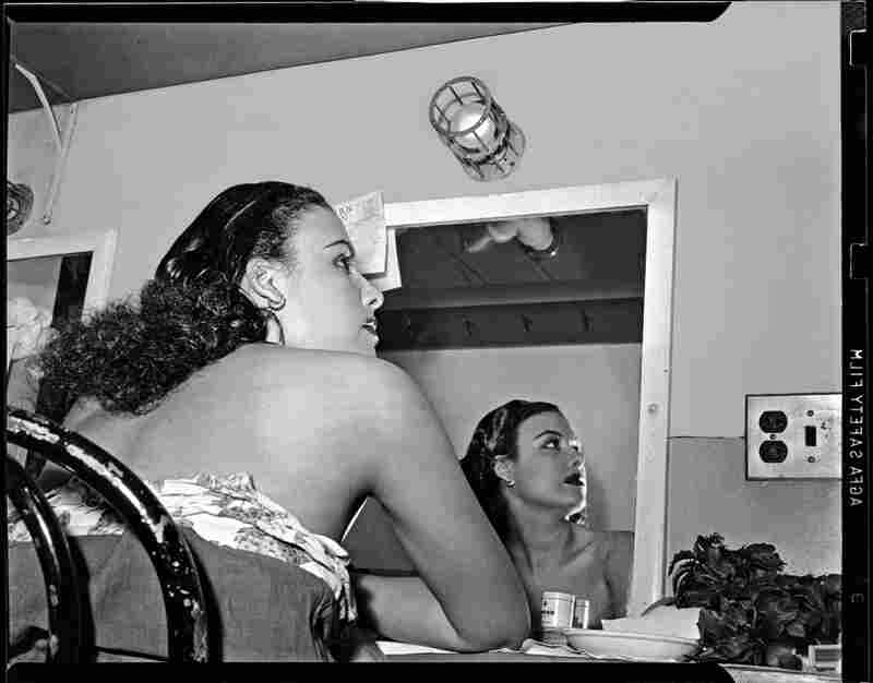 Lena Horne is reflected in a mirror in her dressing room at Stanley Theatre, circa 1944.
