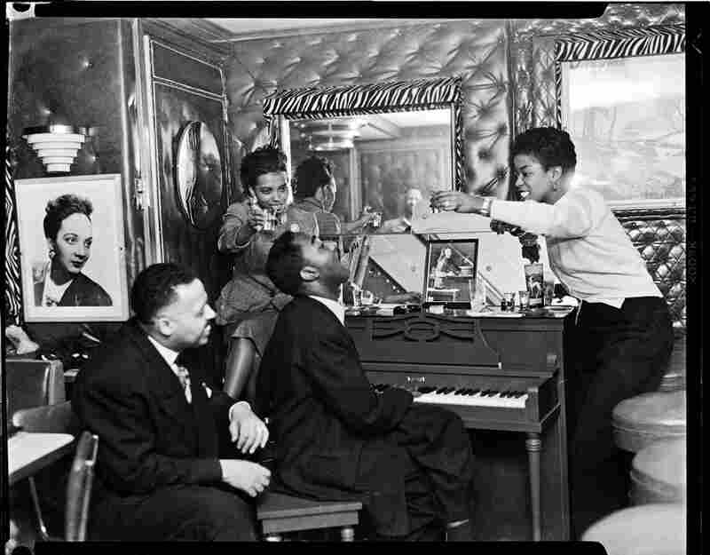 Frank Bolden at left and Sarah Vaughan at right, with another woman and man at piano, circa 1950.