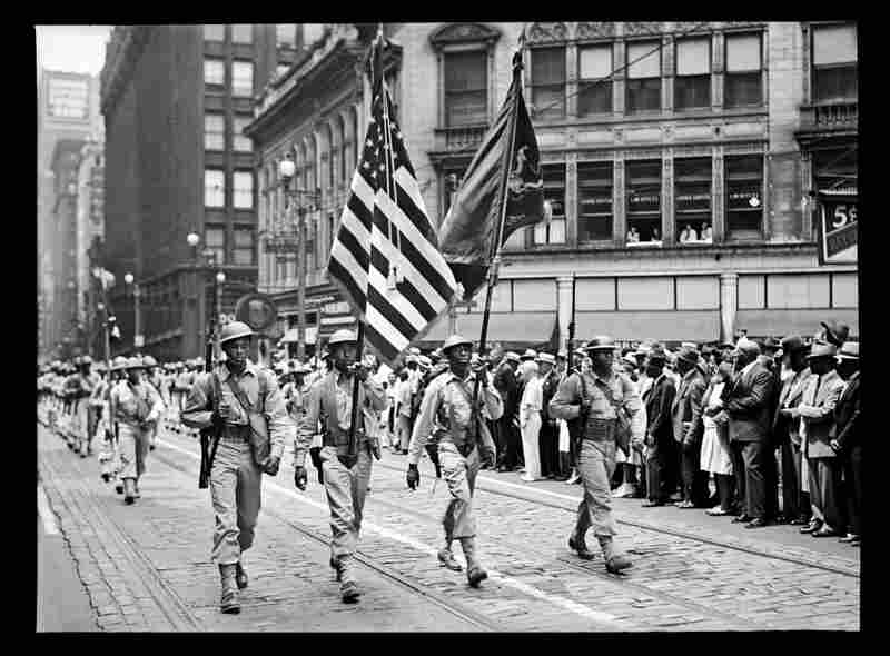 Soldiers from the 372nd Infantry march in a parade down Fifth Avenue, July 1942.