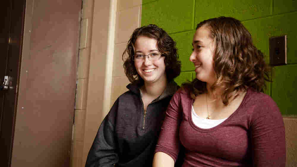Laurel Fontaine, 16, (left) and her twin sister Heather. When Laurel was 11 years old, she suffered a stroke that destroyed 80 percent of the left side of her brain. The singing therapy helped her regain the ability to speak.