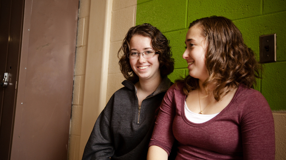 Laurel Fontaine, 16, (left) and her twin sister Heather. When Laurel was 11 years old, she suffered a stroke that destroyed 80 percent of the left side of her brain. The singing therapy helped her regain the ability to speak. (Ellen Webber for NPR)