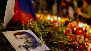 A picture of former Czech President Vaclav Havel lay among candles and floral tributes as people gathered in Prague on Thursday to honor him.