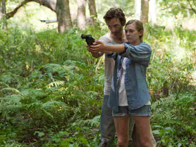 Patrick (John Hawkes) recruits Martha (Elizabeth Olsen) into a abusive cult — and remakes her identity with a folk song.
