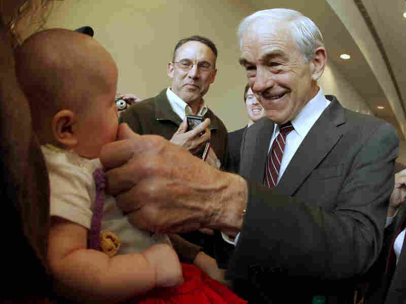 Rep. Ron Paul, R-Texas, greets 3-month-old Heidi Lange during a campaign stop in Dubuque, Iowa, on Thursday.