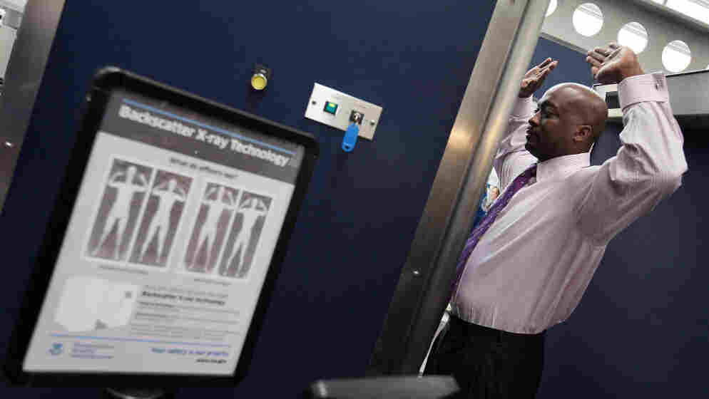 A Transportation Security Administration volunteer demonstrates a full-body scanner at Chicago's O'Hare International Airport in March 2010.
