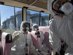 Tokyo Electric Power Co. officials and Japanese journalists look at the crippled Fukushima Dai-ichi plant in November. International media swarmed to cover the problems at the plant, but coverage died down before interest did.
