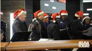 TSA workers sing at Los Angeles International Airport in this screen grab from a USA Today video. The chorus dons Santa hats during the holiday season and perform in the middle of the airport.