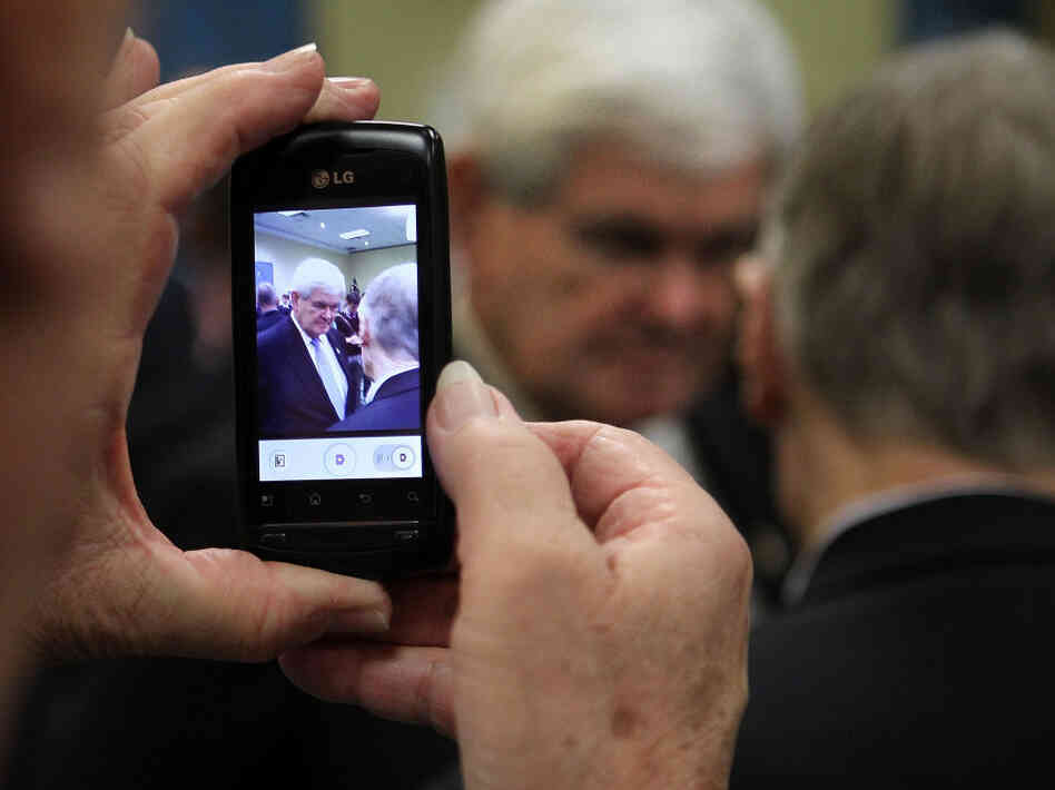 A supporter takes a photo with a cell phone as former Speaker of the House Newt Gingrich greets supporters Dec. 22 in Richmond. Gingrich said then that he would gather enough signatures to make the Virginia ballot, but over the weekend he failed to qualify.