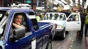 St. Paul resident Lois Neisen, left, drives a Ranger truck off the line after workers have checked that the vehicle's hood, doors and gas cap are flush at the Twin Cities Assembly Plant in St. Paul, Minn., Thursday, Dec. 1, 2011 during a media tour. Neisen has worked at the Ford plant for 21 years. Her husband retired from the plant, and her son worked at the plant for a time.