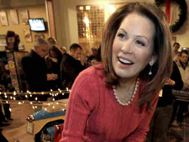 In a last bout of campaigning before Christmas, Rep. Michele Bachmann of Minnesota signs autographs at the National Motorcycle Museum in Anamosa, Iowa, on Dec. 22.