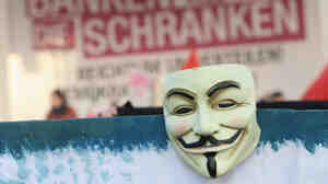 The Guy Fawkes mask has come to symbolize the group Anonymous. This mask was seen during protest in Germany.