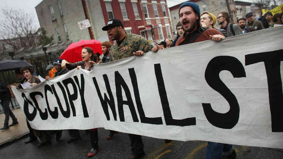 Occupy Wall Street protesters march through in an impoverished community in Brooklyn to protest home foreclosures. Many see the movement's dynamic strategies and aims