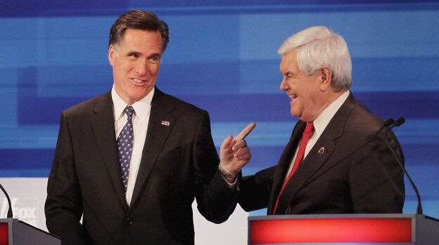 Former Speaker of the House Newt Gingrich and former Massachusetts Gov. Mitt Romney chat after finishing a GOP debate