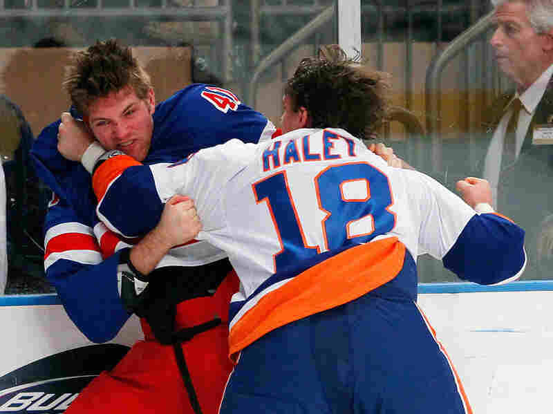 Michael Haley of the New York Islanders fights Stu Bickel  of the New York Rangers in the first period of an NHL game at Madison Square Garden in New York City, Dec. 26.
