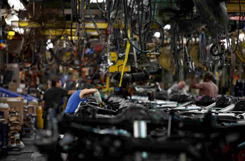 Ford employees assemble parts for Ranger pickup trucks. The last Ranger rolled off the line weeks ago as the plant prepares to close.