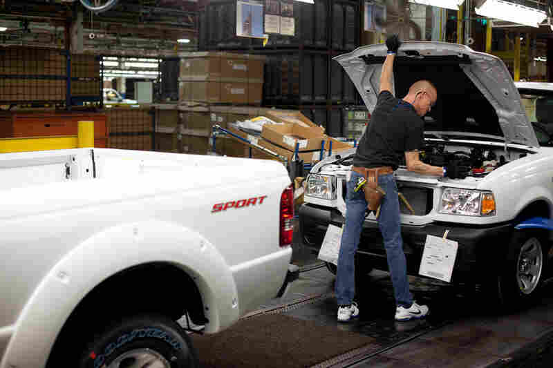 Steve Overby makes sure the hood of each Ranger pickup truck is flush before it comes off the production line.