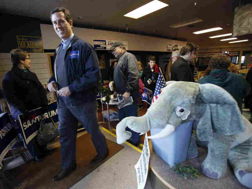 Former Pennsylvania Sen. Rick Santorum leaves the Fort Dodge, Iowa, GOP headquarters after speaking Tuesday.