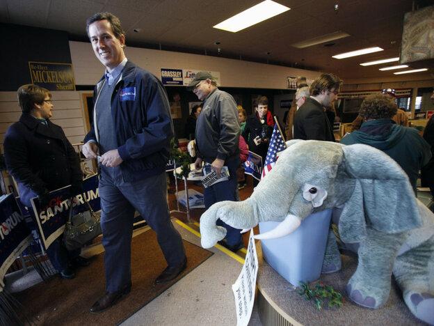 Former Pennsylvania Sen. Rick Santorum leaves the Fort Dodge, Iowa, GOP headquarters after speaking Tuesday.