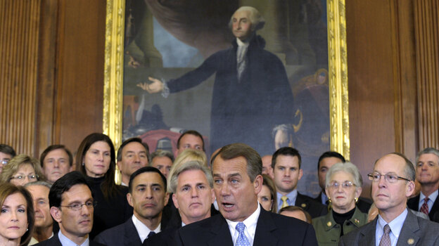 House Speaker John Boehner, surrounded by Republican House members, speaks during a news conference in Washington last week. The House initially rejected a plan to extend a tax cut for two months to buy time for talks on a full-year renewal. It later compromised — a rare event i