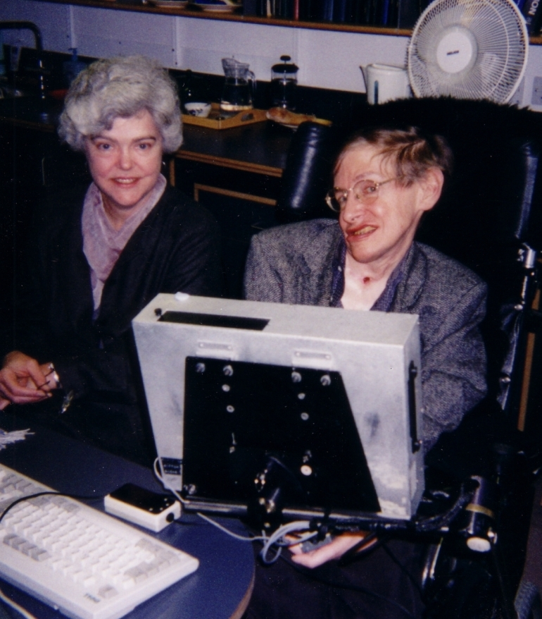 Science writer Kitty Ferguson sits next to Stephen Hawking in this undated photograph. Ferguson is the author of several books about physics, including Stephen Hawking: Quest for a Theory of Everything and Black Holes in Spacetime.