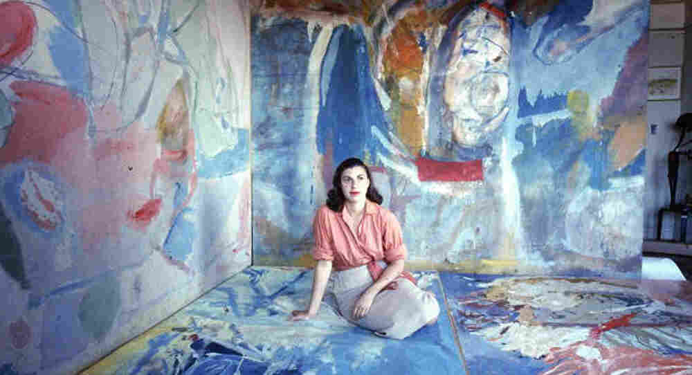 "Abstract expressionist artist Helen Frankenthaler, pictured above in 1956, adopted Jackson Pollock's technique of painting canvases laid flat on the floor. She sought to ""marry"" the paint with the canvas, she said."