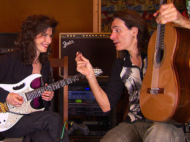 Sharon Isbin (left) and Steve Vai switch axes.