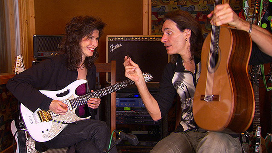 Sharon Isbin (left) and Steve Vai switch axes.