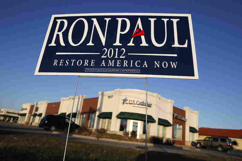A campaign sign for Republican presidential candidate U.S. Rep. Ron Paul of Texas sits at an intersection in Ankeny, Iowa on Dec. 27.