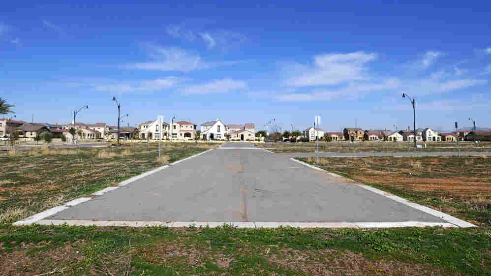 "Unfinished subdivisions like this one in the Phoenix suburb of Gilbert, Ariz., have led urban planners to suggest ""smart decline"" strategies that sometimes even dismantle existing infrastructure."
