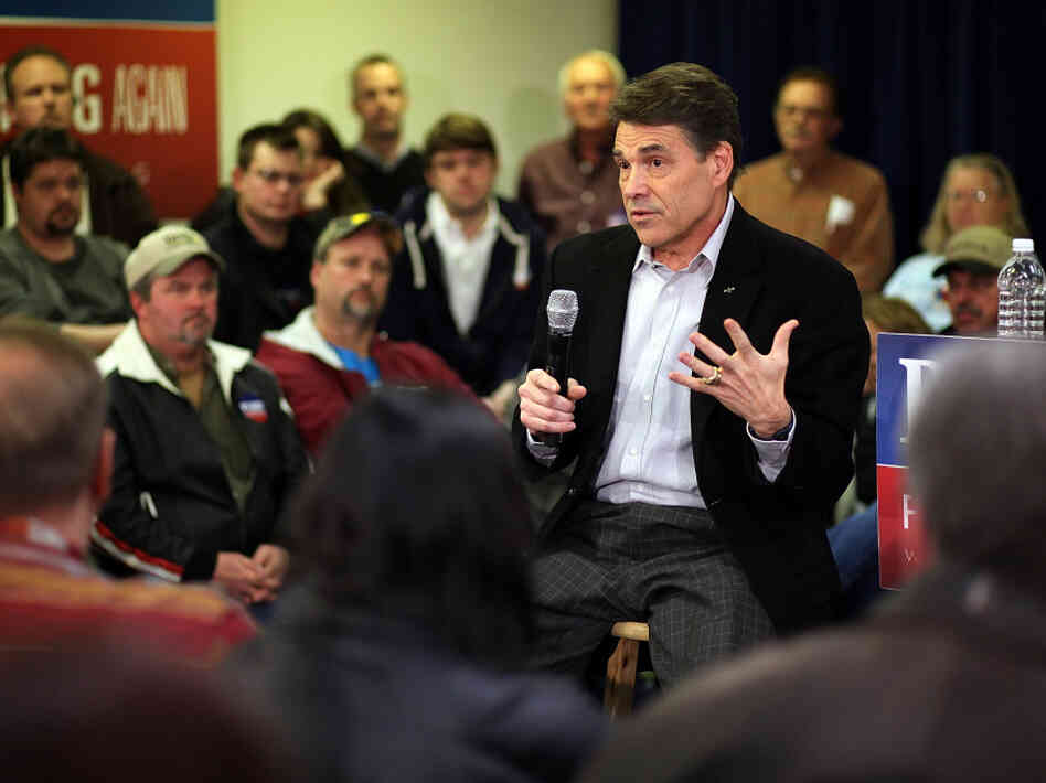 Texas Gov. Rick Perry speaks at a campaign event at Clark Electric Co-op on Dec. 27 in Osceola, Iowa. Perry's stance on immigration has troubled some Iowa voters.