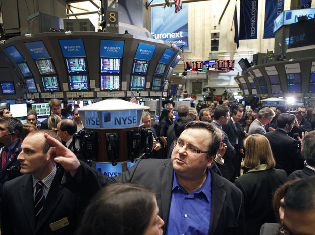 LinkedIn founder Reid Hoffman watches as his company is listed on the New York Stock Exchange in May. Despite the global economic uncertainty, tech companies held steady on Wall Street.