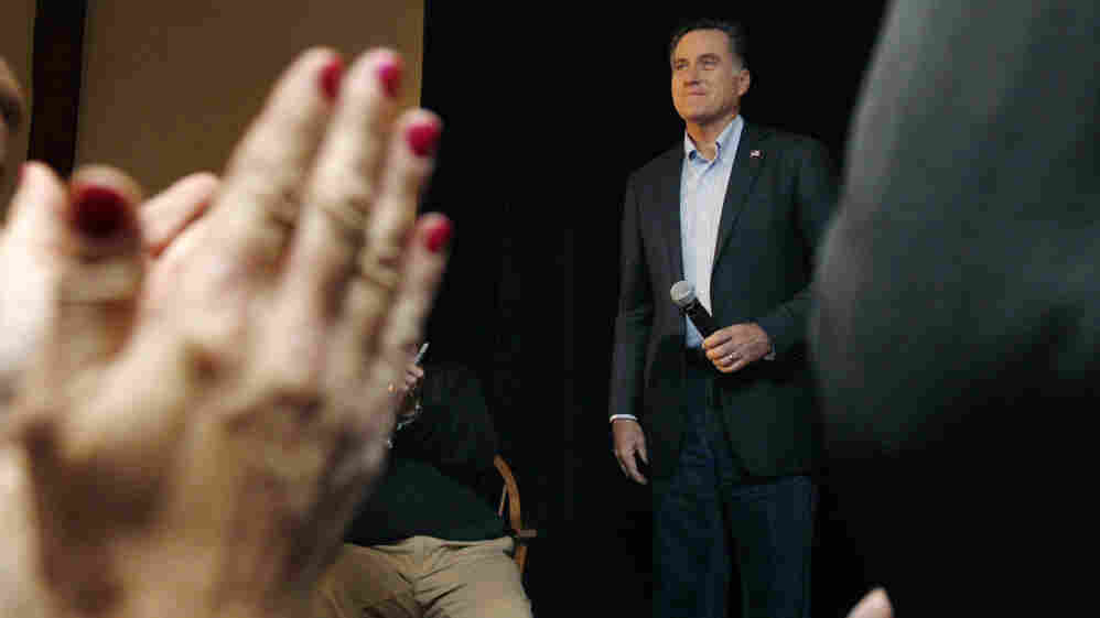 Former Massachusetts Gov. Mitt Romney stands to applause during a campaign stop at a Londonderry, N.H., restaurant on Tuesday.