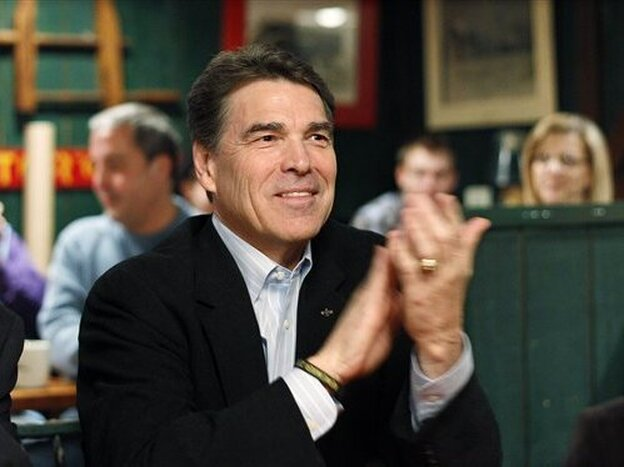 Texas Gov. Rick Perry attends the Westside Conservative Club breakfast Wednesday in Urbandale, Iowa.
