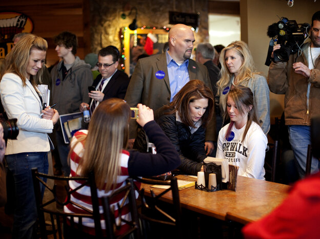 Minnesota Rep. Michele Bachmann signs autographs at the Pizza Ranch in Indianola, Iowa, on Wednesday. The restaurant was largely empty aside from a few local Iowans, media and Bachmann staff.