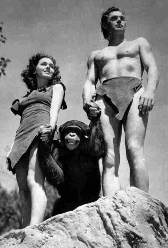 1932 scene from Tarzan the Ape Man: Johnny Weissmuller, right, as Tarzan, Maureen O'Sullivan as Jane, and one of the chimps who played Cheetah.