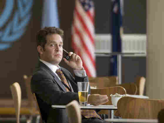 "When a low-level British minister (Tom Hollander) steps into the spotlight with an awkward comment on ""unforeseeable"" war, international decision-making quickly spirals out of control."