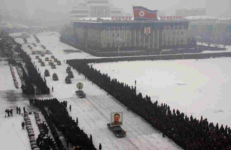 Hundreds of thousands of North Koreans line the route of Kim Jong Il's funeral cortege in snowfall as the late leader's body is driven through the streets of the capital Pyongyang.