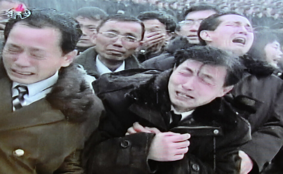 This still frame taken from North Korean TV shows North Koreans mourning during the funeral ceremony for the late leader Kim Jong Il in Pyongyang.  (AFP/Getty Images)