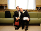 Same-sex couple Joseph and Jim pose for a photo as they wait to be officially married at the Manhattan City Clerk's Office on July 24, 2011, the first day gay couples were allowed to legally marry in New York.