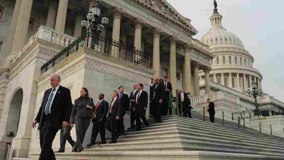 Lawmakers walk down the House steps to leave for the Christmas holiday.