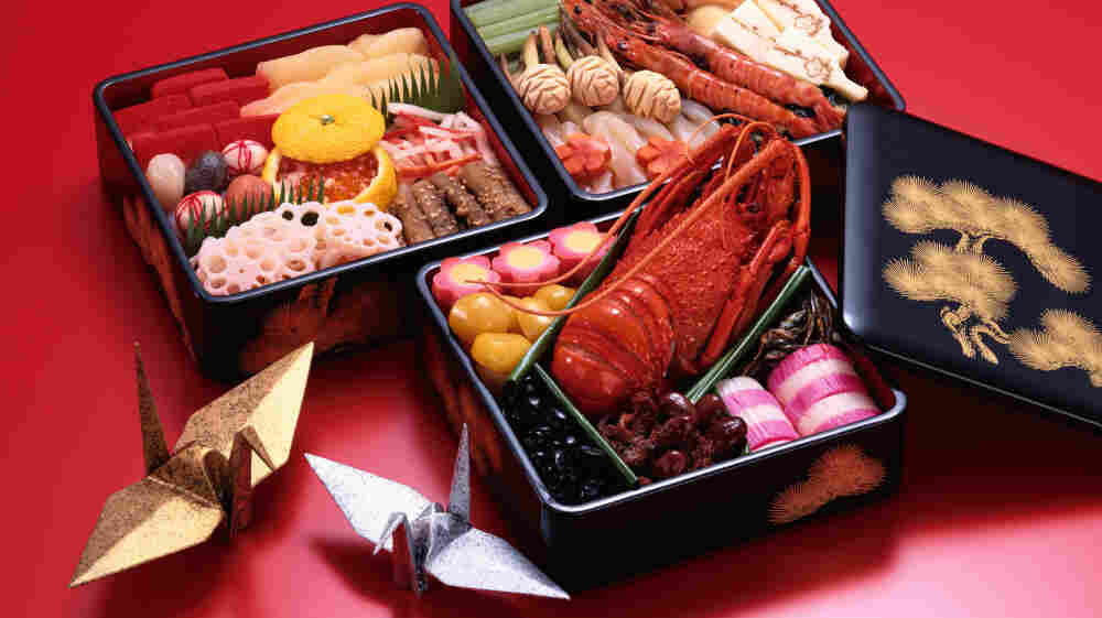 In Japan, the colorful New Year's meal is packaged in special, lacquered boxes.